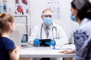 doctor with face mask on talking with patients